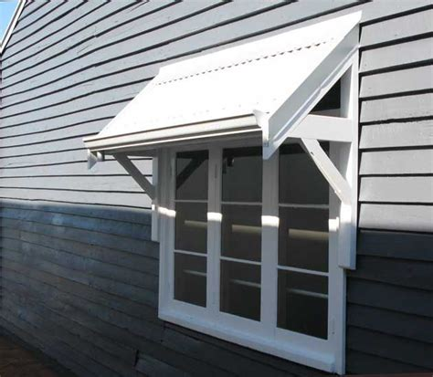 awning bracket google search home improvement pinterest small house exteriors smallest