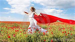 Woman Running With Red Scarf In Poppy Field Royalty Free ...