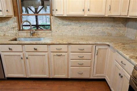 White Cabinets With Granite That Has More Brown In It