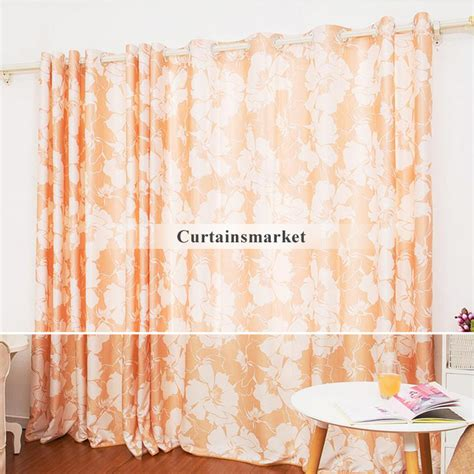 orange patterned curtains of floral patterns in 2 panels