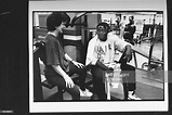 Actor Yaphet Kotto in sweat clothes & headband, chatting w ...