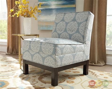 sky blue button tufted armless accent chair with black legs