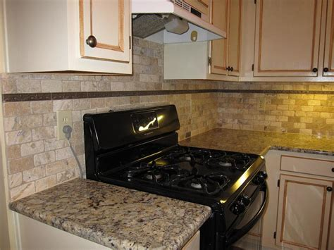 simple kitchen design with natural tumbled stone subway