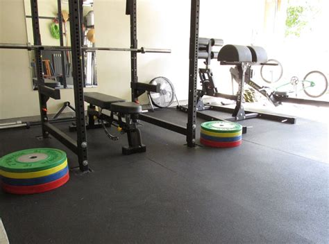 Floor Lowers Fast by Working With Securing Stall Mats In A Garage