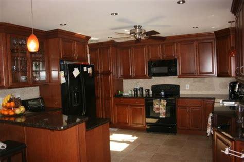 kraftmaid chestnut maple cabinets warm spicy kitchen