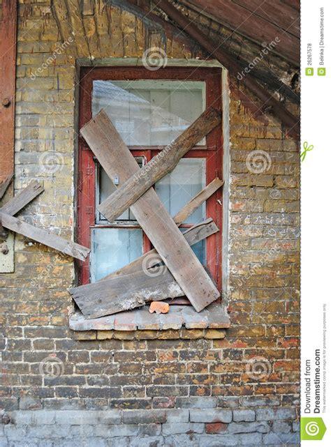 covered windows  abandoned  brick house stock