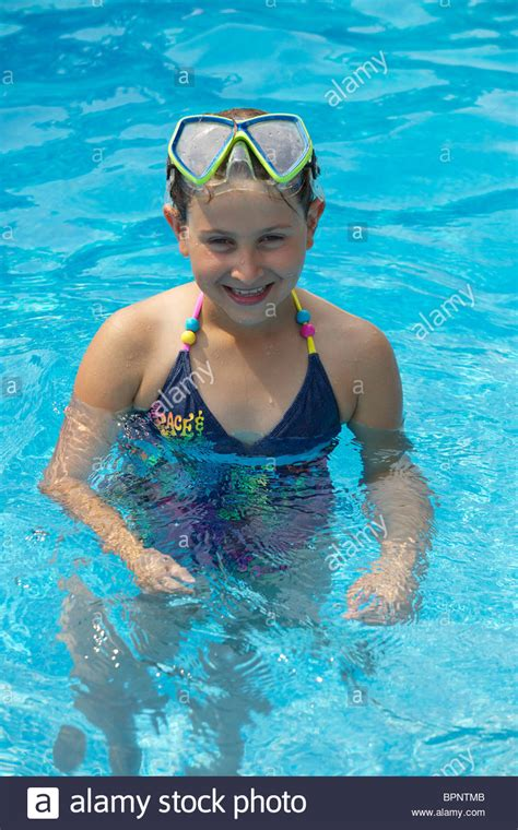 Portrait Of Smiling Young Girl In A Swimming Pool Stock