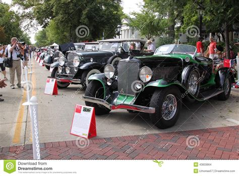 A Line Of Incredible Cars Down The Street Editorial Stock