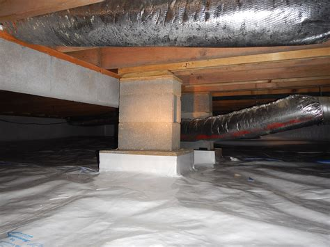crawlspace block piers added to a beam between the floor joists that is preventing the sub