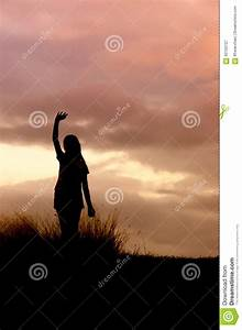 Woman Standing Alone At The Field During Sunset Stock ...