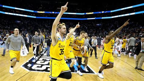 march madness  umbcs win earns