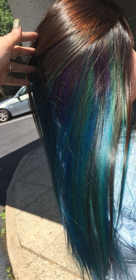 Blue Blend With Hint Of Purple Underneath Layer Of Dark