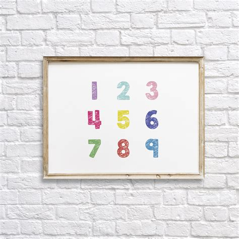 Peel and stick wall decals are a great solution! Colorful Numbers Nursery Wall Decor Printable - Dgtally