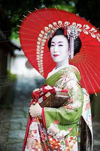 A, Woman, Dressed, In, The, Traditional, Geisha, Style, Wearing, A
