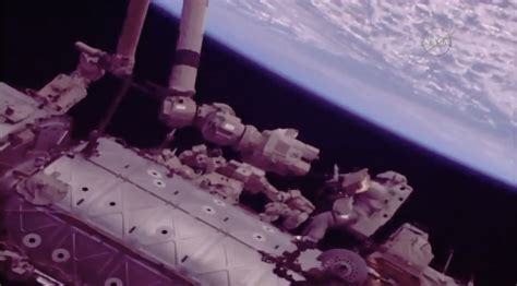 spacewalking astronauts complete robot arm work spaceflight now