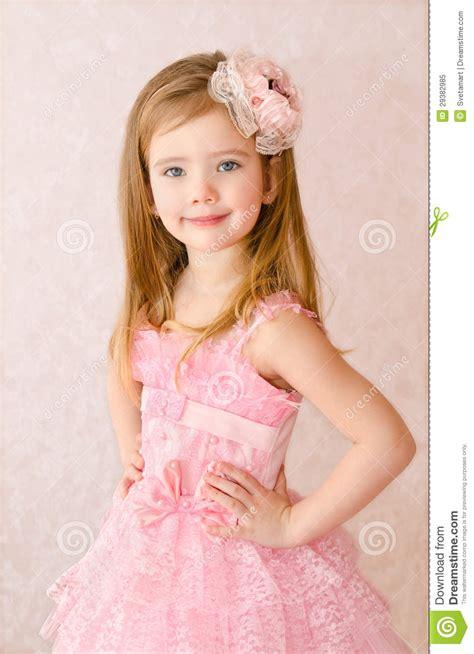 Portrait Of Smiling Little Girl In Princess Dress Stock