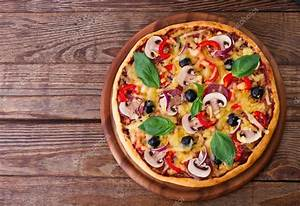 Pizza with seafood on wood table top view Stock Photo