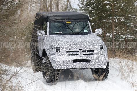 ford bronco  door caught playing   snow