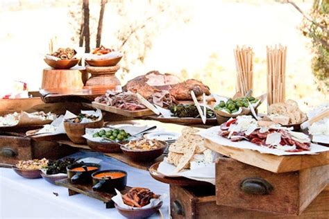 table canape a rustic canapé table with wooden boards of charcuterie