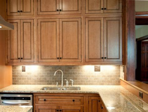 raised panel cabinets bring elegance   kitchen space