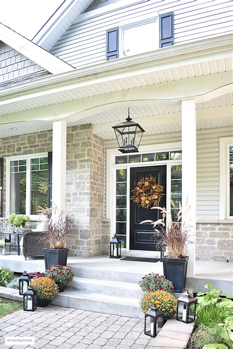 elegant front porch decorated  fall