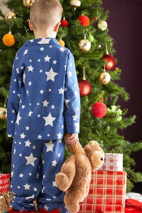 full length portrait   boy  pajamas holding teddy