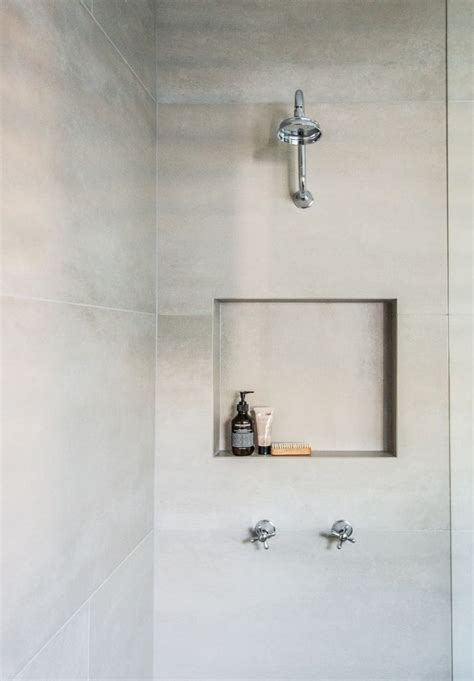 large format tiles   shower area means  grout