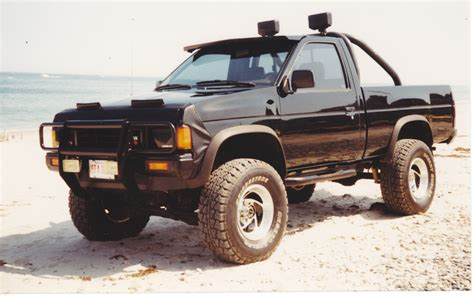 nissan pickup 4x4 front end sagging but t bars already cranked up 90 95
