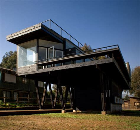 harmonious house on stilts designs literal house oceanfront summer home sits on stilts