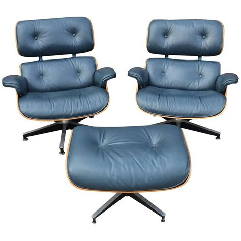 navy blue herman miller eames lounge chair set for