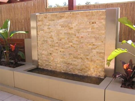 stacked stone clad water feature  standing paint rendered ideal  courtyard  patio
