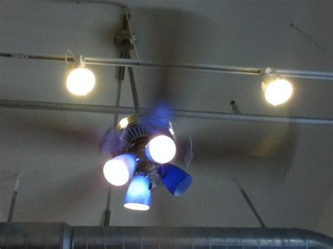 lights installed above spinning ceiling fan causes