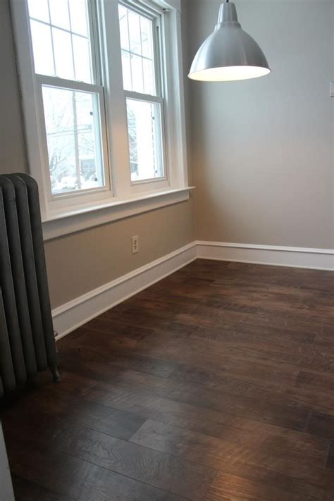 vinyl plank flooring on walls brown wooden allure vinyl plank flooring matched with cream wall plus white baseboard molding