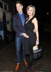 Katherine Kelly and husband Ryan Clark tenderly cradle her ...