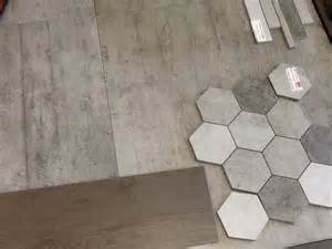 this honeycomb tile for feature wall in shower and concrete tile for floor bathroom