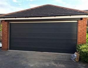 Porte de garage : Ouverture Enroulable Budget Maison