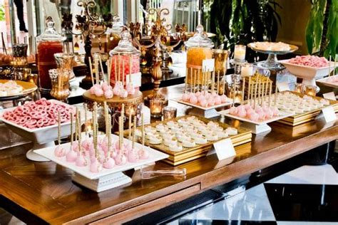 the sweet table boutique gold and gum pink dessert bar