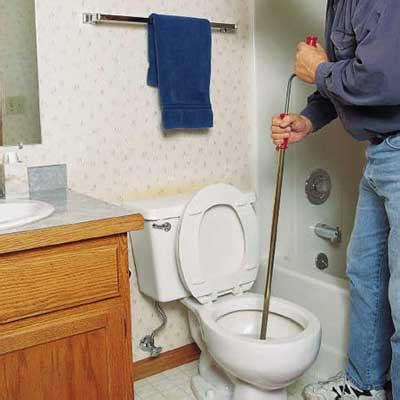 free a toilet clog crank and repeat how to clear any clogged drain this house