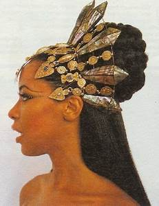 aaliyah ...in a goddess inspired golden metal headdress ...