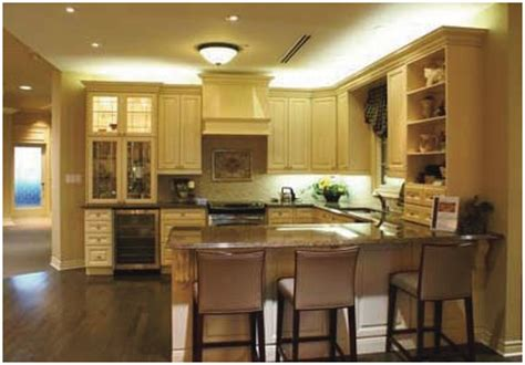 lighting above kitchen cabinets what should you do with the awkward space above kitchen 7023