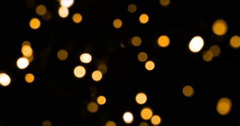 black and gold christmas lights defocused bokeh gold christmas light on dark background horizontal pan stock video footage
