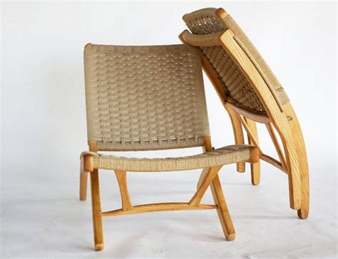 mid century hans wegner style teak and rope lounge chair