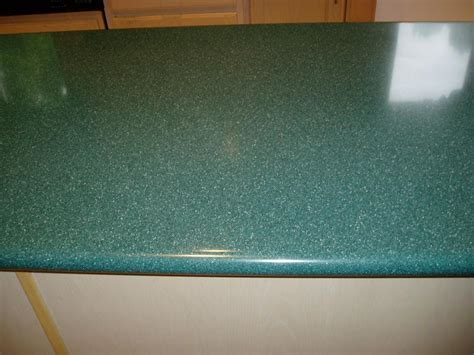 Solid Surface Restorations, LLC.   SCRATCHED TOP