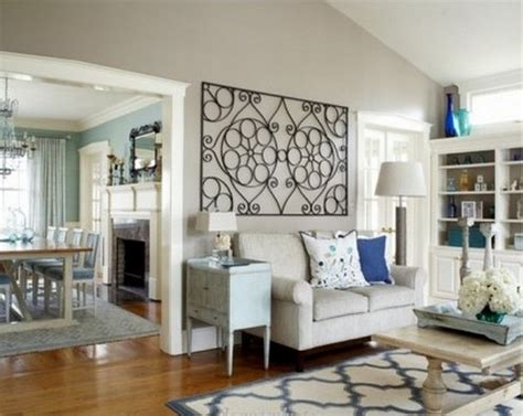 Instead, choose smaller pieces that can be laid like a collage or gallery wall like the contemporary living room. Wrought iron wall decor adds elegance to your home