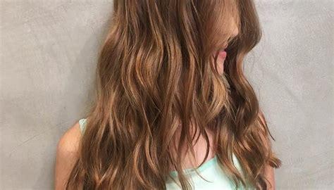 Women's Long Wavy V-cut Layers On Warm Light Brown Hair