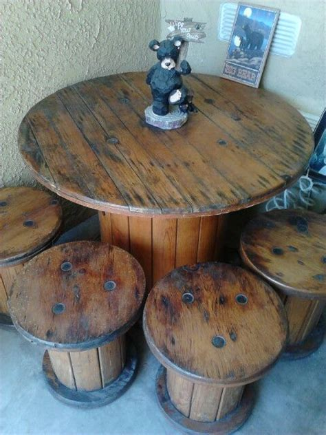 large wooden spools used for tables spool table with small spool seats cable spool ideas