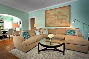 Teal and tan living room looks comfortable and modern for Teal and tan living room