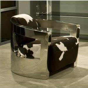 Fauteuil peau de vache et inox for Tapis peau de vache avec canape convertible haut dossier
