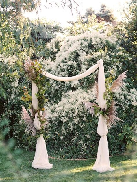 use bark covered wire to attach flowers to wedding arch