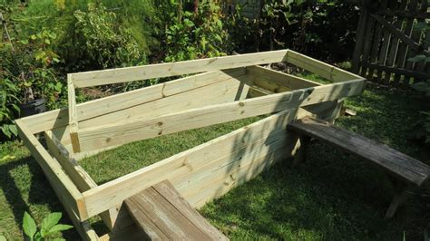 Build A Garden by How To Build A Raised Bed Vegetable Garden Frame Cost